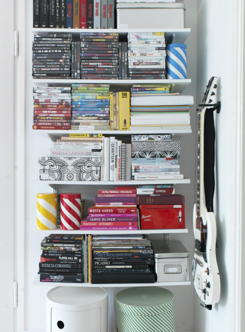 To keep her open storage neat, Susanna stacks and organizes her books and DVDs by size and by color. Fine Finnish - Photo 11 of 16