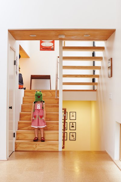 Just inside, Pippa, one half of the ever-entertaining twins, goofs around on the stairs leading from the entrance to the main floor and the bedrooms below.