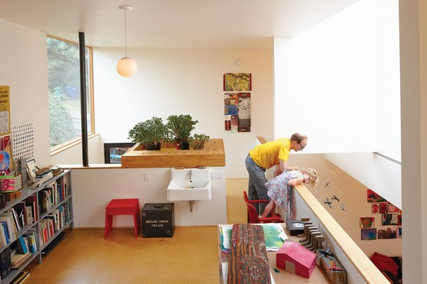 The upstairs loft is an office-cum-craft room. Evidence of the family's DIY nature is omnipresent. Hale built a planter box and art-supply cubbies with leftover plywood. The space is equipped with plumbing hookups in case—or more likely, when—the family chooses to convert the area into a third bedroom and bathroom.