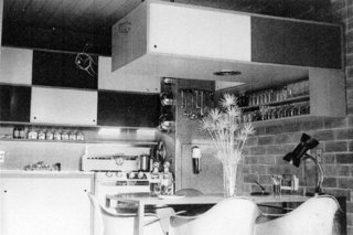 The original kitchen was a little pocket kitchen with a small dining area and overhead cabinet.