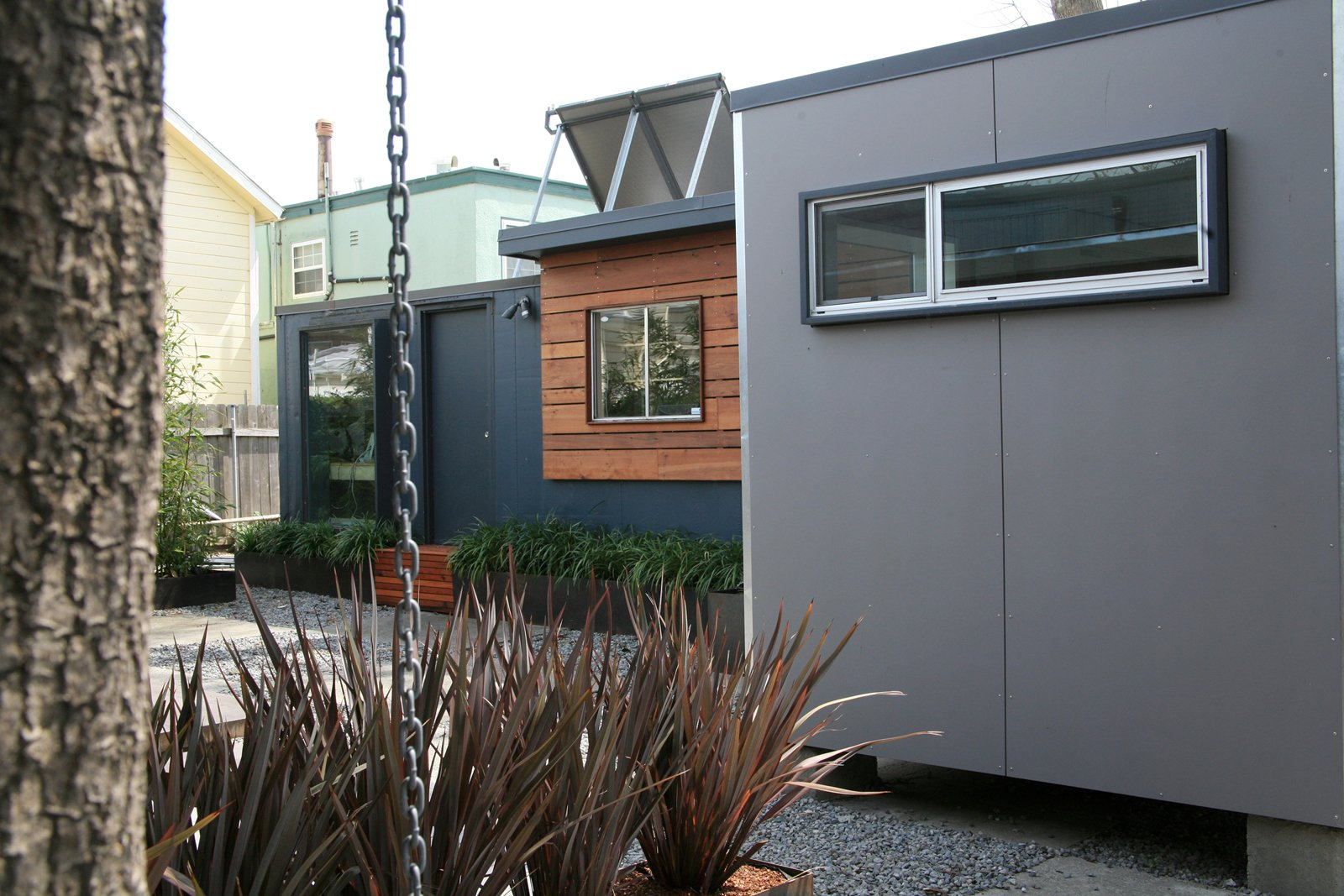 """We're trying to create a sense of enclosure and privacy in an urban area without putting up a walled city,"" says Shoup. Photo by building Lab inc.  Shipping Containers by Dwell from Creative Re-Use in Oakland"