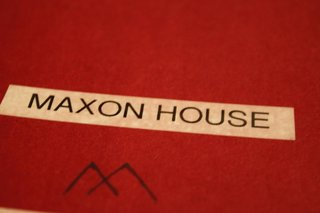 "Notebook cover of one of our inspiration books. Here is where we really started to give the house its own identity, and the ""Maxon House"" name was born. Using the ""M"" from my branding company's logo, we started to concept out a treatment of 'Maxon House' for signage."