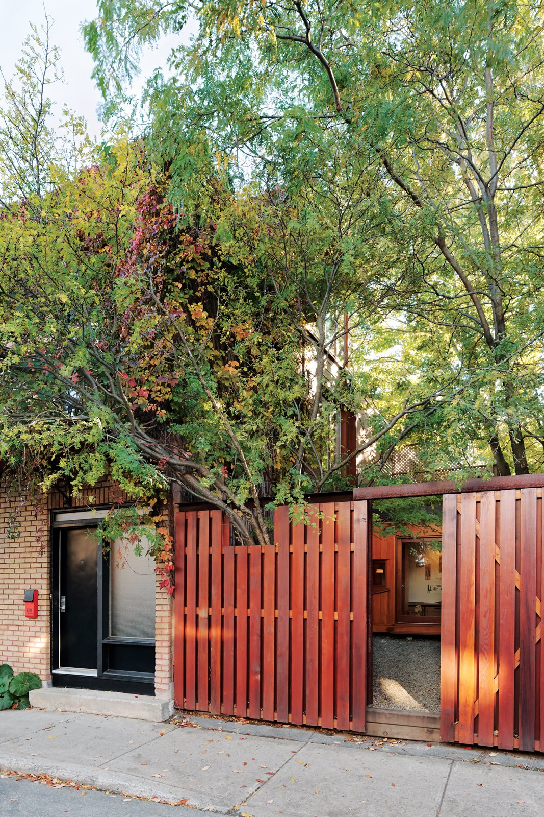 Sheltered behind the fence that runs along the sidewalk, the plantings give the courtyard the feeling of an urban oasis.  30+ Best Modern Fences by William Lamb from Separate Boîte Equal