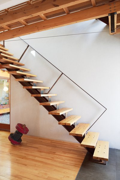 "Keep Right<br><br>To eliminate flex in the cantilevered stairs, Bernier placed the structural stringer off-center. ""When you climb the stairs and hold the rail, you actually step closer to the inside edge,"" he says. He also located the handrail against the wall to keep it from visually interrupting the living room. The custom metalwork is by Félix Lepage.<br><br>felixlepagedesign.com<br><br>Don't miss a word of Dwell! Download our  FREE app from iTunes, friend us on Facebook, or follow us on Twitter!"