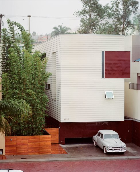 The Becerril family embraces stark modernism with a mute facade clad in Hardie board and acrylic panels. Access to the heart of the house is through the bamboo garden.