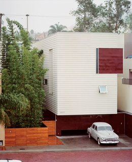 Modern in Tijuana - Photo 5 of 13 - The Becerril family embraces stark modernism with a mute facade clad in Hardie board and acrylic panels. Access to the heart of the house is through the bamboo garden.
