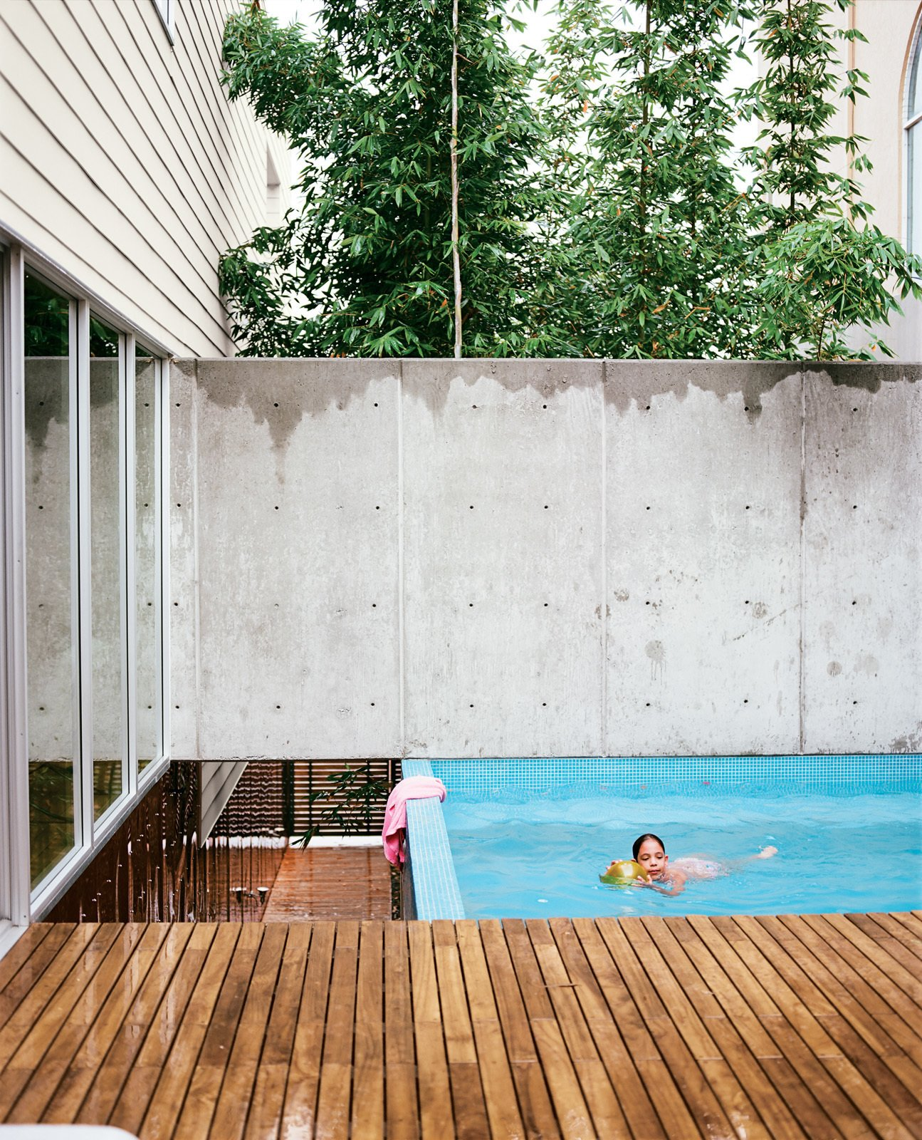 The small pool at the top of the landing provides the family with a place to cool off.  30+ Best Modern Fences by William Lamb from Modern in Tijuana