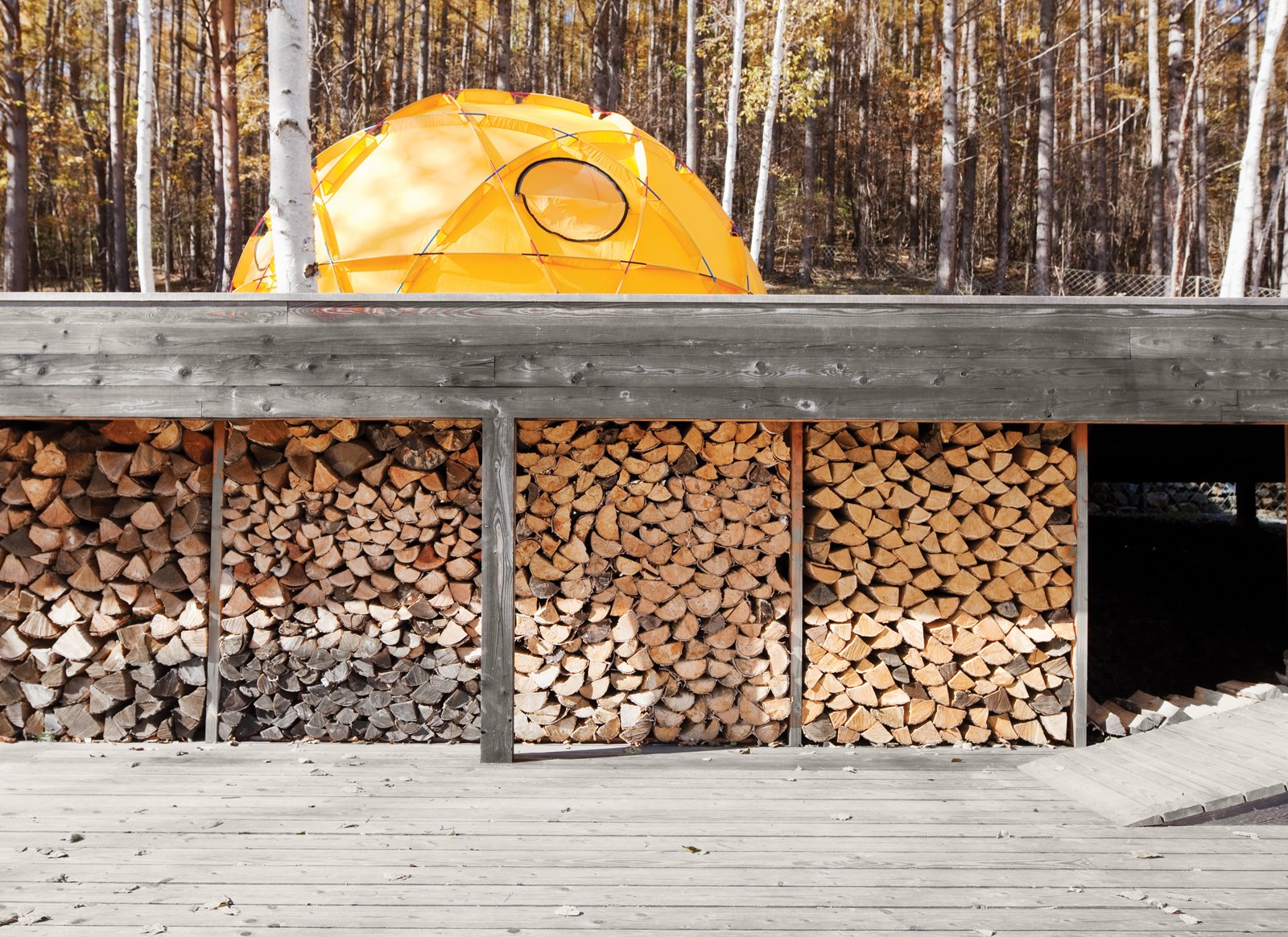 A stockpile of wood sheltered from the elements. Tagged: Outdoor, Large Patio, Porch, Deck, and Wood Patio, Porch, Deck. A Platform for Living - Photo 15 of 28