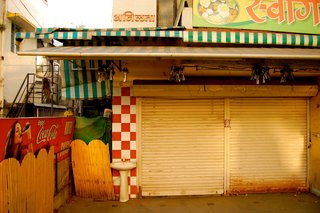 Touring India - Photo 8 of 27 - During the day, storefronts are packed with people. I coveted my time alone in the streets in the morning hours before the hustle and bustle started. These same storefronts, when closed, had a dramatically different energy.