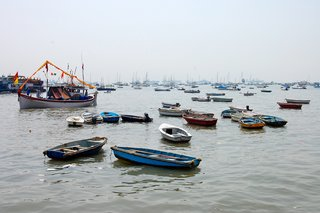Touring India - Photo 17 of 27 - In Mumbai's harbor, boats speckle the water. They looked to be so close to one another that I imagined being able to jump from one to the next like lilly pads.