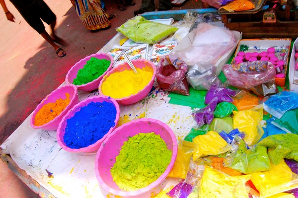 The Holi paints, sold in powder form, would later make their way from these tables onto my skin.