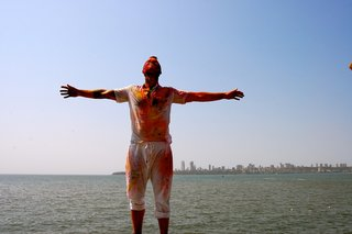 Touring India - Photo 20 of 27 - After a day of celebrating I walked, covered in paint, along the water.