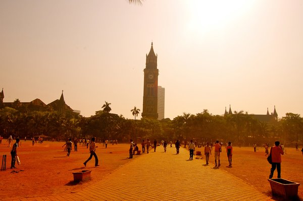 Hundreds of men played cricket below the University of Mumbai's Rajabai Clock Tower, which was modeled after Big Ben.