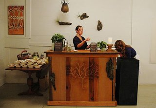 A Tree Grows in the Dogpatch - Photo 2 of 7 - Maggie Wilson of Maggie Wilson Events prepares and serves treats sourced from the Treehouse urban garden.