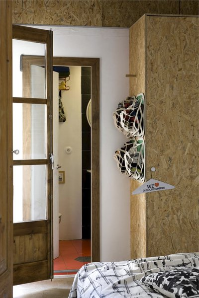 StuffBumps, the eco-friendly pop-up storage system that Scholtus designed with Graham Hill of the sustainability resource TreeHugger, hang on one side of a wardrobe constructed of oriented strand board (OSB), chosen because it contains minimal amounts of resin compared to other engineered woods.