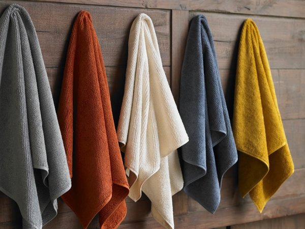 Organic cotton towels, available in eight neutral and jewel-tone hues.