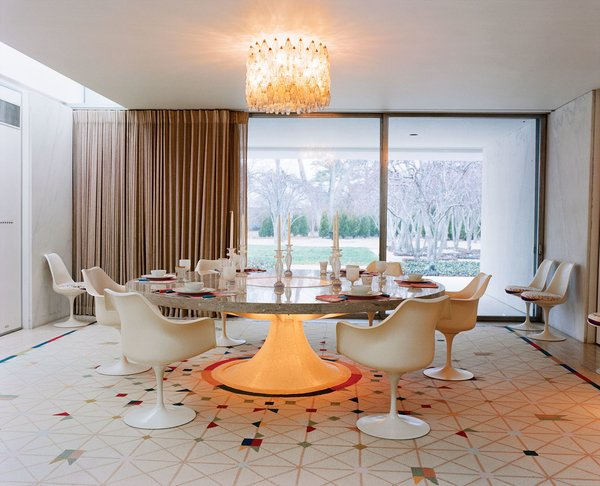 The dining room centers around a custom Saarinen-designed marble-and-terrazzo table ringed by Tulip chairs. Overhead is a Venini chandelier. Photo 4 of Miller House in Columbus, Indiana by Eero Saarinen modern home