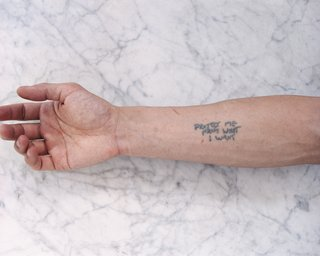The Wong Show - Photo 7 of 7 - Tobias Wong, Protect Me From What I Want, 2002; artist tattoo; © Estate of Tobias Wong. Photo courtesy SFMOMA.