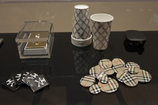 The Wong Show - Photo 3 of 7 - Another selection of objects on display including Unauthorized Burberry Buttons (1999). Burberry took to Wong's shenanigans and used the pins in one of their advertising campaigns. Photo courtesy SFMOMA.
