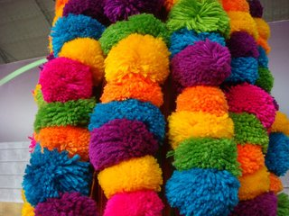 Color Me Mad! - Photo 15 of 31 - Colorful pompoms in all the vibrant colors found throughout the fair.
