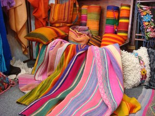 Traveling With Michelle - Photo 4 of 5 - A trove of yet more vibrantly colored rugs, pillows, and blankets.