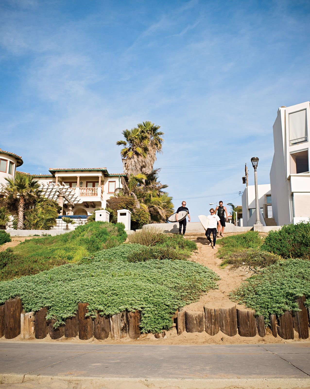 The trio walks down to the beach via the strand.  Photo 3 of 18 in Less is More in this Manhattan Beach Bungalow