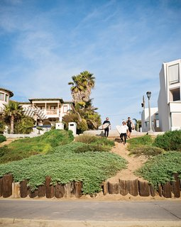 Less is More in this Manhattan Beach Bungalow - Photo 3 of 18 - The trio walks down to the beach via the strand.