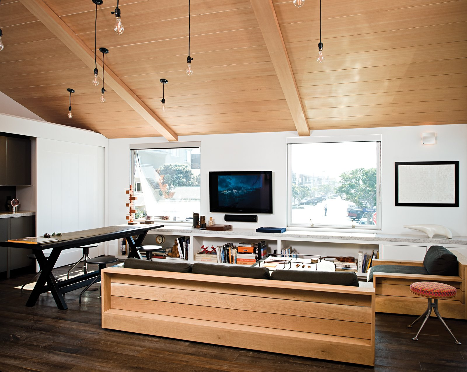 The Marmol Radziner–designed James Perse showroom in Malibu provided aesthetic inspiration for Jacobson, who outfitted his place with furnishings from the brand. Tagged: Living Room, Sofa, and Dark Hardwood Floor.  Photo 5 of 18 in Less is More in this Manhattan Beach Bungalow