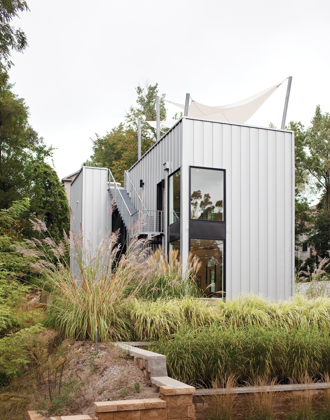 "The home's metal cladding is Pac-Clad, a material typically used for roofs. Tagged: Exterior, Cabin Building Type, House, and Metal Siding Material.  Search ""events-this-weekend-318-21.html"" from Come Sail Away"