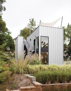 The home's metal cladding is Pac-Clad, a material typically used for roofs.