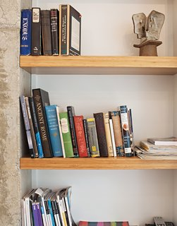 A close-up of the bookshelves made of MDF clad in bamboo veneer.