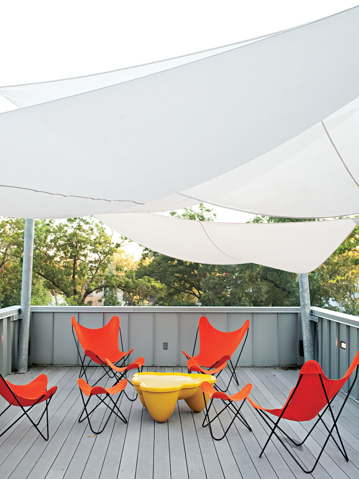 Epic Sail  To reduce heat load and provide shade, DeSalvo initially tracked down a sail system from Sun Shade Australia. But the $6,000 price tag had the architect and contractor designing their own version out of Mermet solar screen fabric. It was fabricated by Covers Unlimited for $1,800.   coversunlimitedinc.com Tagged: Outdoor and Rooftop.  Photo 12 of 25 in Come Sail Away