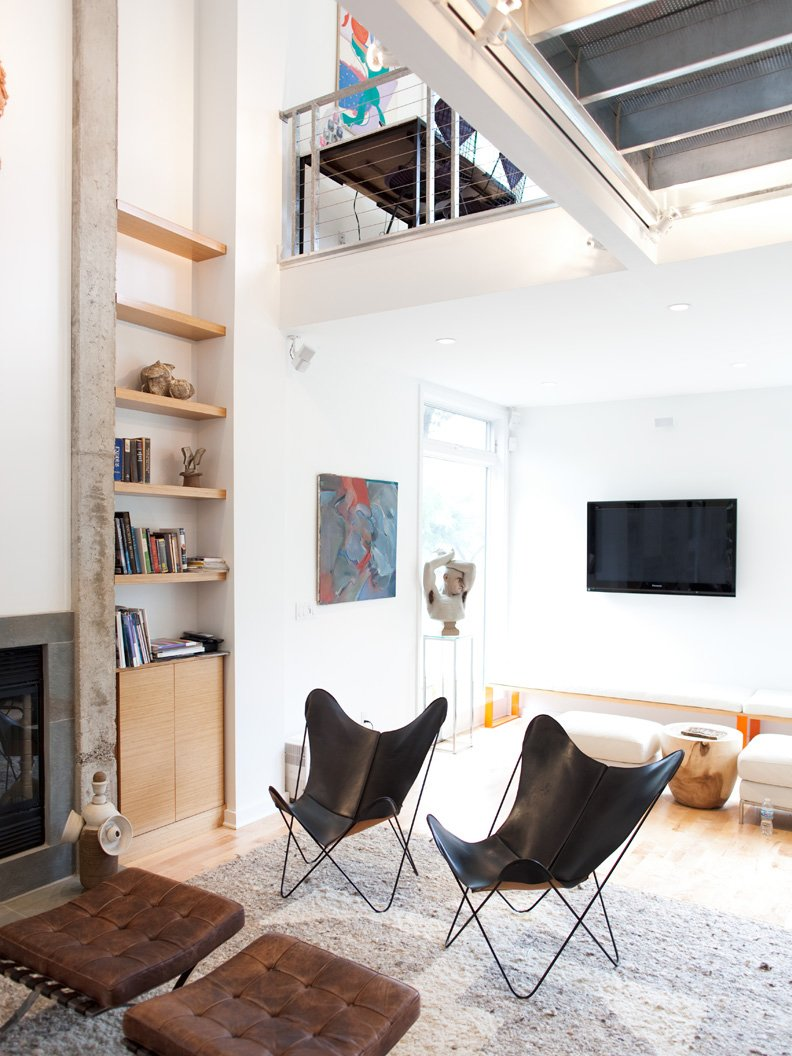 A pair of black leather butterfly chairs face off with Corbusier ottomans in front of the concrete-edged fireplace. Tagged: Living Room, Ottomans, Gas Burning Fireplace, and Chair.  Photo 18 of 25 in Come Sail Away