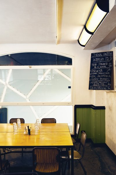 Journal Canteen is decidedly more humble, though its rough interior and simple objects bespeak a charming sophistication.