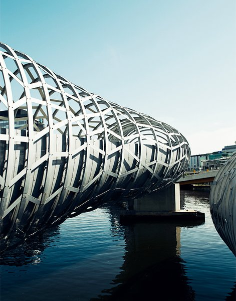 The Webb Bridge in Docklands is a curving footbridge designed by Melbournian superfirm Denton Corker Marshall. It's meant to evoke an aboriginal eel trap.