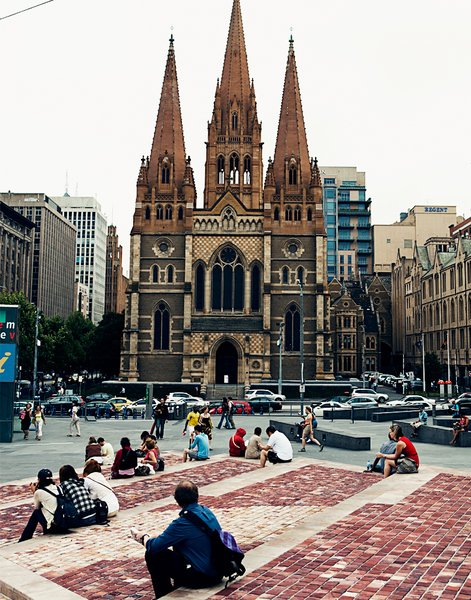 A fine bit of Gothic revival architecture, William Butterfield's St. Paul's Cathedral is seen here from Federation Square just across the street.