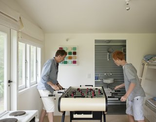 Will and Tom enjoy their other bedroom essential: a foosball table.