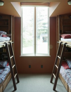 The guest room cleverly shoehorns four bunks into a small footprint.