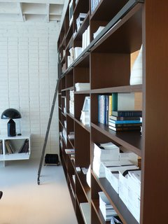 The showroom's System NXT is outfitted with a library ladder and a multitude of design books.