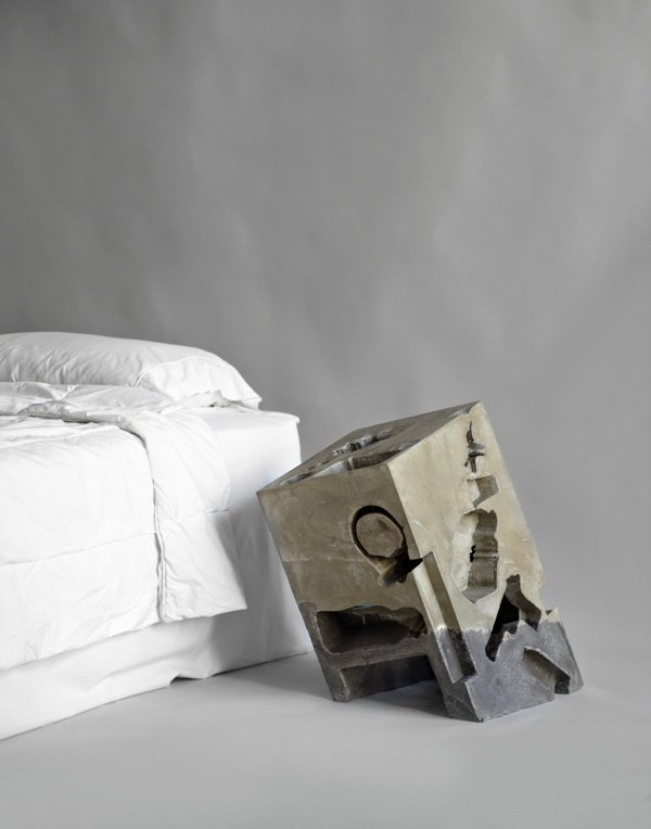 The 200-pound nightstand by Situ Studio is made of two kinds of cement: 'Rapid Set' concrete (the lighter hue) and 'Crack-Resistant Quickrete' concrete (the darker). The off-kilter piece contains cast impressions made in the shape of plastic bottles, paperback novels, keys, and also some, um, sexier shapes...  The Nightstand, Reinvented by Jaime Gillin