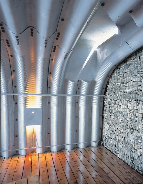 """Being inside the boathouse, with its deep corrugations, is a unique experience. """"You feel like you're in an upside-down boat or in a whale's body,"""" Adam says. """"It's quite beautiful."""""""