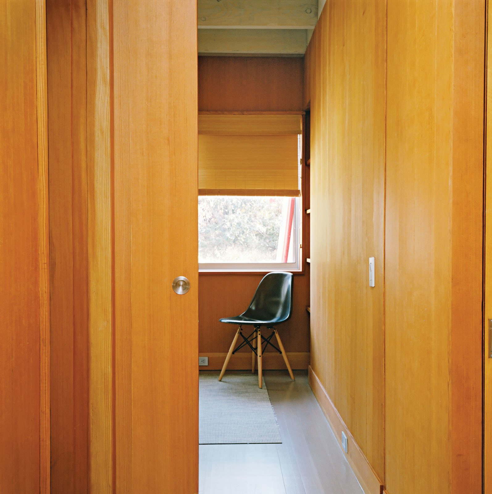 To maximize the limited square footage, there are few swinging doors in the house; instead, each bedroom has a pocket door that slides into the wall. Tagged: Doors, Wood, Sliding Door Type, and Interior. Long Island Found - Photo 5 of 12