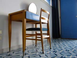 Gio Ponti's Parco dei Principi Hotel - Photo 9 of 29 - Our room was also outfitted with this custom designed desk with attached mirror and an iconic Superleggera chair.