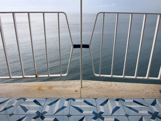 Gio Ponti's Parco dei Principi Hotel - Photo 11 of 29 - A view of the sea through the wrought iron balustrade on our room's balcony.
