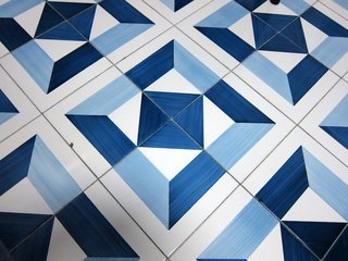 By rotating the individual tiles, this pattern alone could create four distinct layout configurations.