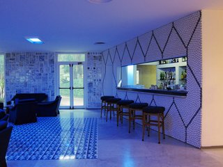 Gio Ponti's Parco dei Principi Hotel - Photo 22 of 29 - The bar itself is faced with more ceramic pebbles with the lobby's color scheme in reverse. One can only imagine how swinging it must have been in 1962.