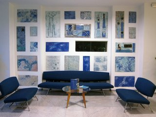 Gio Ponti's Parco dei Principi Hotel - Photo 23 of 29 - The lounge is faced with more sculptural tiles by Fausto Melotti and furnished with a few of the only non-Ponti-designed pieces in the hotel. The seats are the 865 series by Ico Parisi.