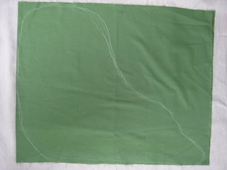 Jabba the Hutt Pillow - Photo 5 of 21 - Fold the green fabric in half, width-wise, and draw out your Jabba shape in chalk.