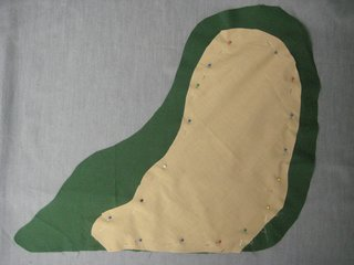 Lay the tan fabric on top of the green, and cut out a piece that will be Jabba's face and belly. It doesn't have to be perfect! You can freehand this part, or draw your shape with chalk and then cut it out. Pin this to one layer of the green fabric.