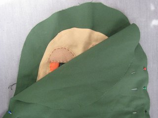 Jabba the Hutt Pillow - Photo 15 of 21 - Pin the right sides of the two green pieces together (Jabba's face will be on the inside). Once they're secure, sew around the outside edge, leaving a few inches open and un-stitched. When you've finished, turn Jabba inside out. At this point he's a pillowcase.